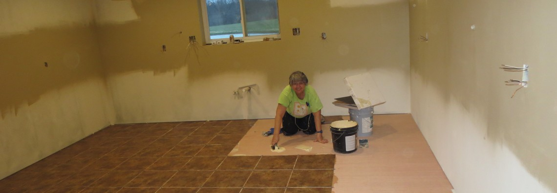 Me, Cherie, laying floor in the kitchen.  This was a super sticky job!